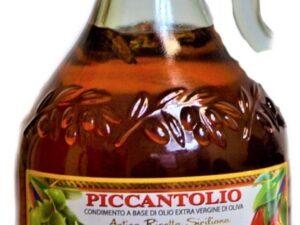 na białym tle butelka ostrej oliwy z oliwek